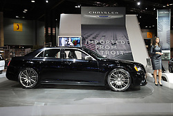 "08  February 2013: 2013 Chrysler 300C automobile. Chicago Auto Show, Chicago Automobile Trade Association (CATA), McCormick Place, Chicago Illinois<br /> <br /> 2013 Chrysler 300: Heading into 2013, the popular Chrysler 300 rear-wheel drive series has simplified product lineup and added more convenience and comfort on new base 300, 300S, 300C and top-tier 300C Luxury levels. (The Chrysler 300 SRT8 is covered separately.) A new edition for 2013 is the Chrysler 300 ""Glacier"" that combines unique design appointments with all-wheel-drive capability to carve through some of the most snow-covered landscapes. Additional standard features on the 300 include heated leather seating, Uconnect 8.4 with voice command and 3.6-liter aluminum Pentastar V-6 engine with state-of-the-art ZF eight-speed automatic transmission. The Chrysler 300 AWD model offers even more all-season capability at a legendary value. For an added avant-garde appearance and performance, the 300S delivers the 3.6L V-6 with new sport-tuned exhaust system and cold-air induction system. This aluminum mill now produces 300 horsepower (8 more than last year) and has an enthusiast desired sound. Beats by Dr. Dre audio technology that includes a 522-watt 12-channel amplifier is standard on the Chrysler 300S and available on other 300 models. Stock powerplant on the 300C is the 363hp 5.7L V-8 with standard five-speed automatic transmissions. On the exterior, large 20-inch polished face wheels for rear-wheel drive only, and 19-inch with all-wheel drive, provide the sedans with an even more planted and road-holding look. Every 2013 Chrysler 300 variants come with a comfortable five-passenger cabin that exudes luxury, and a tailored trunk that can handle 16.3 cubic feet of luggage."