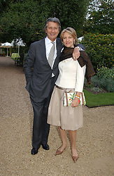 ARNAUD and CARLA BAMBERGER at the annual Cartier Flower Show Diner held at The Physics Garden, Chelsea, London on 23rd May 2005.<br />