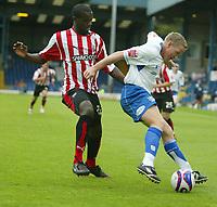 Photo: Aidan Ellis.<br /> Bury FC v Brentford. Coca Cola League 2. 01/09/2007.<br /> Bury's Glynn Hurst holds off Brentford's Karleigh Osborne