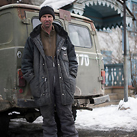 'Schumacher'. Taxi driver, Kyrgyzstan. He shares his driving licence with his twin brother.