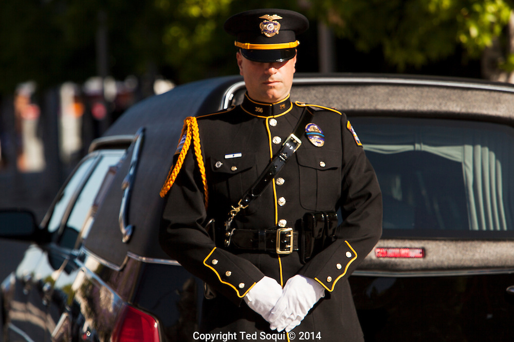 LAX Airport Police Honor Guard in front of the hearse.<br /> Funeral Mass for LAPD Officer Roberto Sanchez held at the Cathedral of Our Lady of the Angels in Los Angeles. Officer Sanchez was killed while on duty during a police pursuit, when a suspects vehicle intentionally rammed Sanchez's LAPD cruiser.