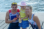 """Henley on Thames, United Kingdom, 3rd July 2018, Saturday,  """"Henley Royal Regatta"""",  Leander Club Olympians, celebrating Leander 200 year row past, showing Olympic medals to a young fan,  left Pete REED, right Victoria (Vicky) THORNLEY.  View, Henley Reach, River Thames, Thames Valley, England, UK."""