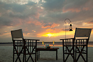 Set up for drinks at sunset, Zanzibar, Tanzania. http://www.gettyimages.com/detail/photo/cocktail-table-for-two-on-beach-at-sunset-royalty-free-image/182986708