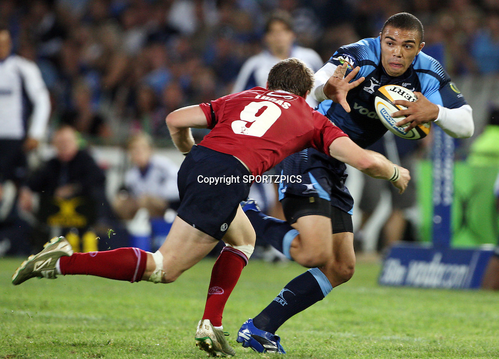 PRETORIA, South Africa, Brian Habana stopped by Ben Lucas during the Super 14 match between the Bulls and the Reds held at Loftus Versfeld in Pretoria on the 14 February 2009..Photo By Barry Aldworth/ SPORTZPICS