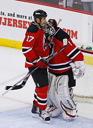 Nov 1, 2008; Newark, NJ, USA; New Jersey Devils left wing Mike Rupp (17) congratulates New Jersey Devils goalie Kevin Weekes (1)after their 6-1 win over the Atlanta Thrashers at the Prudential Center.