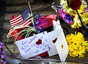 Flowers and notes are left outside Chatlos Chapel in tribute to Rev. Billy Graham at the Rev. Billy Graham at the Billy Graham Training Center at the Cove on Thursday, Feb. 22, 2018 in Asheville, NC. (AP Photo/Kathy Kmonicek)