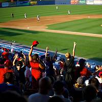 Fans cheer during a game with the Trenton Thunder at the Reading Phillies First Energy Stadium in Reading, PA on July 16, 2013.