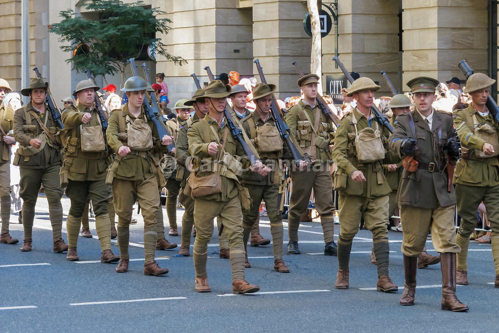 Soldiers in old World War 1 uniforms march during Brisbane ANZAC day 2013 parade <br />