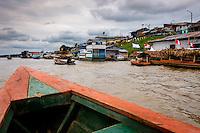 NAUTA, PERU - CIRCA OCTOBER 2015:  Boat approaching the port of Nauta in the Peruvian Amazon.