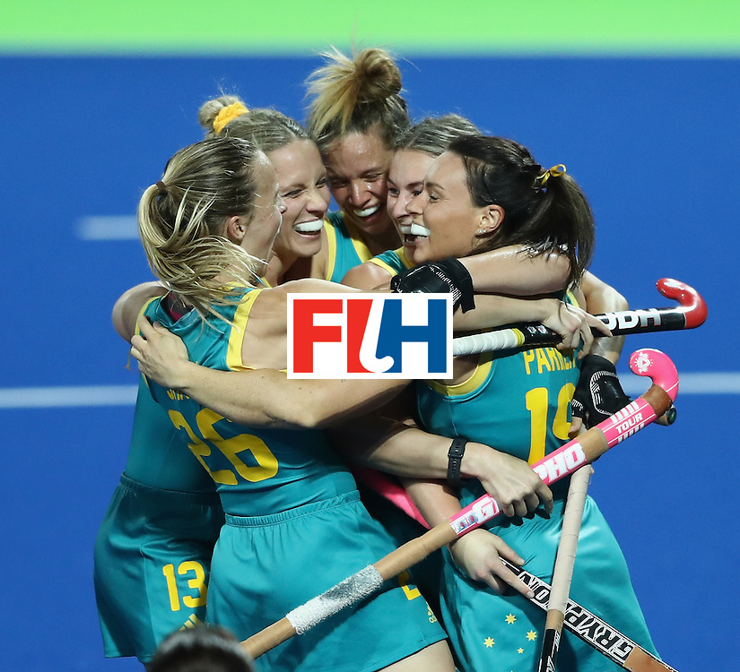 RIO DE JANEIRO, BRAZIL - AUGUST 13:  Austalia celebrate their victory during the Women's Pool B hockey match between Australia and Japan on Day 8 of the Rio 2016 Olympic Games at the Olympic Hockey Centre on August 13, 2016 in Rio de Janeiro, Brazil.  (Photo by David Rogers/Getty Images)