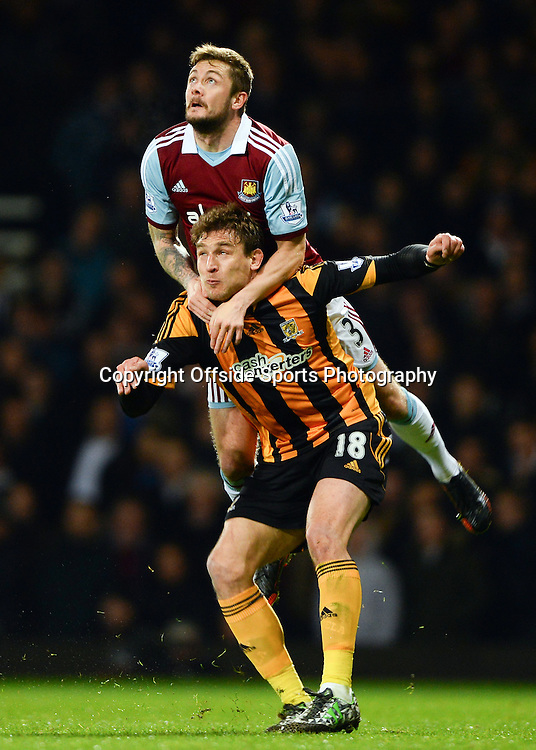26 March 2014 - Barclays Premier League - West Ham United v Hull City - George McCartney of West Ham United tangles with Nikica Jelavic of Hull City - Photo: Marc Atkins / Offside.