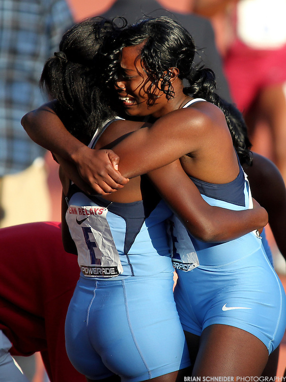 April 27, 2012; Philadelphia, PA, USA; Edwin Allen (Clarendon, JAM) teammates react after winning the High School Girls' 4x400 Championship of America at the Penn Relays at Franklin Field in Philadelphia, PA. Mandatory Credit: Brian Schneider-www.ebrianschneider.com