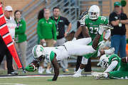 Marshall Thundering Herd running back Keion Davis (24) dives for a first down against the North Texas Mean Green during the 1st half at Apogee Stadium in Denton, Texas on October 8, 2016. (Cooper Neill for The Herald-Dispatch)