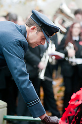 Flt Lt Paul Stringer of 370 Squadron ATC lays a wreath at the War Memorial during the  local Remembrance Day service in Chapeltown Park Sheffield South Yorkshire. This year also marks the 90th Anniversary of the Royal British Legion and according to local people the parade was particularly well attended...13 November 2011. Image © Paul David Drabble