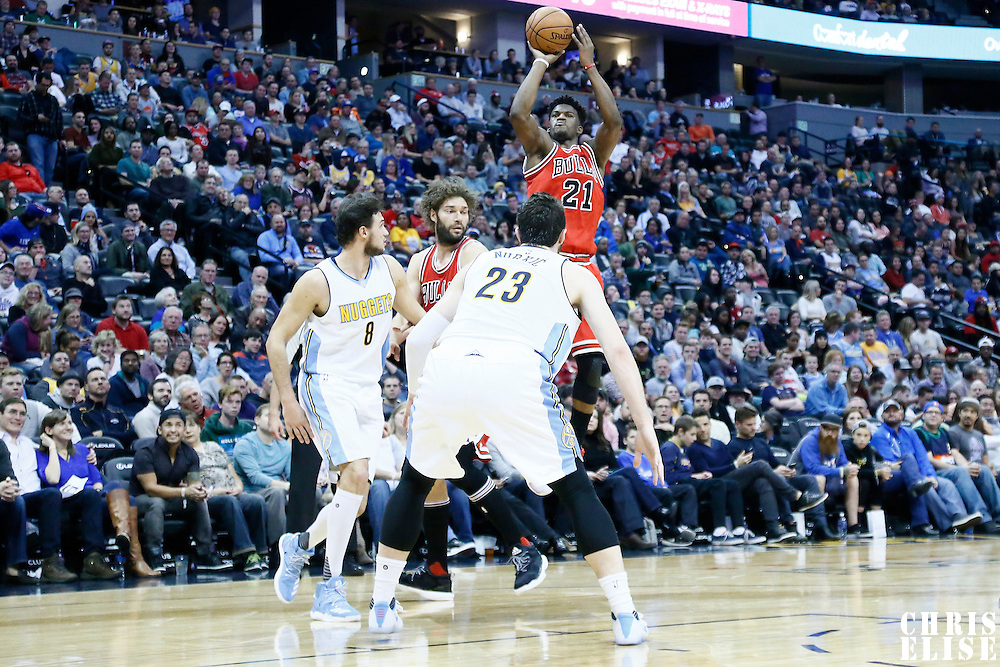 22 November 2016: Chicago Bulls forward Jimmy Butler (21) takes a jump shot over Denver Nuggets forward Danilo Gallinari (8) and Denver Nuggets center Jusuf Nurkic (23) during the Denver Nuggets 110-107 victory over the Chicago Bulls, at the Pepsi Center, Denver, Colorado, USA.