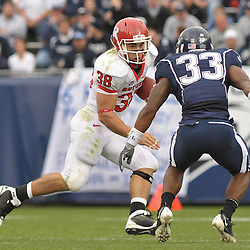 Oct 31, 2009; East Hartford, CT, USA; Rutgers running back Joe Martinek (38) looks for a way past Connecticut safety Robert Vaughn (33) during second half Big East NCAA football action in Rutgers' 28-24 victory over Connecticut at Rentschler Field.