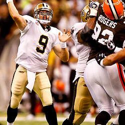 Oct 24, 2010; New Orleans, LA, USA; New Orleans Saints quarterback Drew Brees (9) throws a pass against the Cleveland Browns during the first half at the Louisiana Superdome. Mandatory Credit: Derick E. Hingle