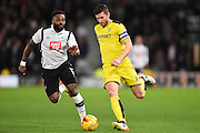 Derby County forward Darren Bent (11) battles with Burton Albion defender John Mousinho (4) during the EFL Sky Bet Championship match between Derby County and Burton Albion at the Pride Park, Derby, England on 21 February 2017. Photo by Jon Hobley.