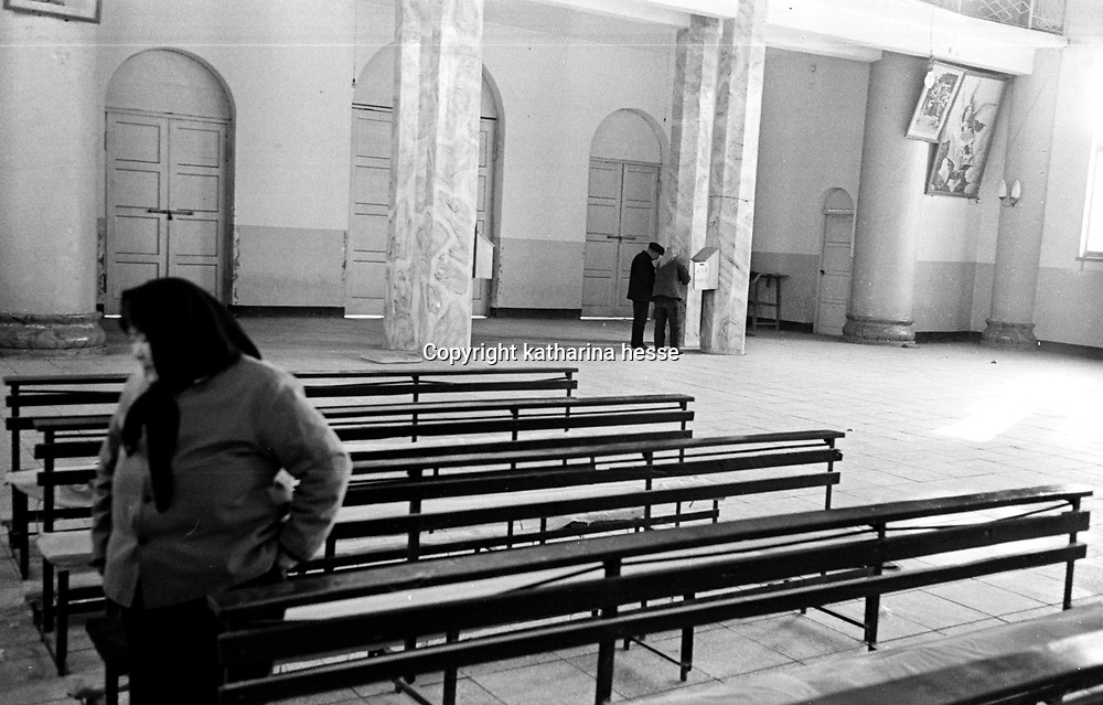 DONGLU, 11 MARCH 2001:an elderly woman leaves the church after mass. China cut relations with the vatican in the early fifites and since then, established a Patriotic catholic Church that's controlled by Chinese authorities.<br />Catholics who refused to give up their ties with the Vatican, started worshipping in underground churches and consequently were persecuted for a long time. Since the late nineties though, relations with the vatican informally started to improve. Although China still has no diplomatic relations, many representatives from official churches met the pope John Paull II secretely . Since the pope's death on Saturday, thousands of catholics commemorate John Paull II  in special masses throughout China.
