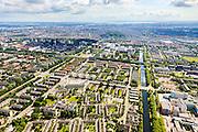 Nederland, Noord-Holland, Amsterdam, 14-06-2012; overzicht zuidelijk deel van de wijk Slotervaart met onder in beeld het complex van De Drie Hoven (gecombineerd verpleeghuis en verzorgingshuis, architect Herman Hertzberger). Links de Cormelis Lelylaan, rechts het water van de Slotervaart en de Plesmanlaan. Boven het midden de ringspoorlijn, Overtoomse veld en flats langs de ring A10, Naar de horizon het centrum van Amsterdam met Vondelpark en het IJ, IJsselmeer aan de verre horizon.  .De wijk is onderdeel van de Westelijke Tuinsteden, gerealiseerd op basis van het Algemeen Uitbreidingsplan voor Amsterdam (AUP, 1935). Voorbeeld van het Nieuwe Bouwen, open bebouwing in stroken, langwerpige bouwblokken afgewisseld met groenstroken. .Overview garden city Slotervaart. This residential area Slotervaart is an example of garden cities of Amsterdam-west. Constructed on the basis of the General Extension Plan for Amsterdam (AUP, 1935). Example of the New Building (het Nieuwe Bouwen), detached in strips, oblong housing blocks alternated with green areas, built in fifties and sixties of the 20th century.  The skyline of Amsterdam on the horizon. .luchtfoto (toeslag), aerial photo (additional fee required).foto/photo Siebe Swart