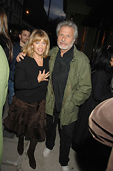 Fashion designer EDINA RONAY and her husband MR DICK POLAK at an exhibition of paintings by artist Rene Richard at the Scream Gallery, Bruton Street, London on 3rd April 2008.<br />