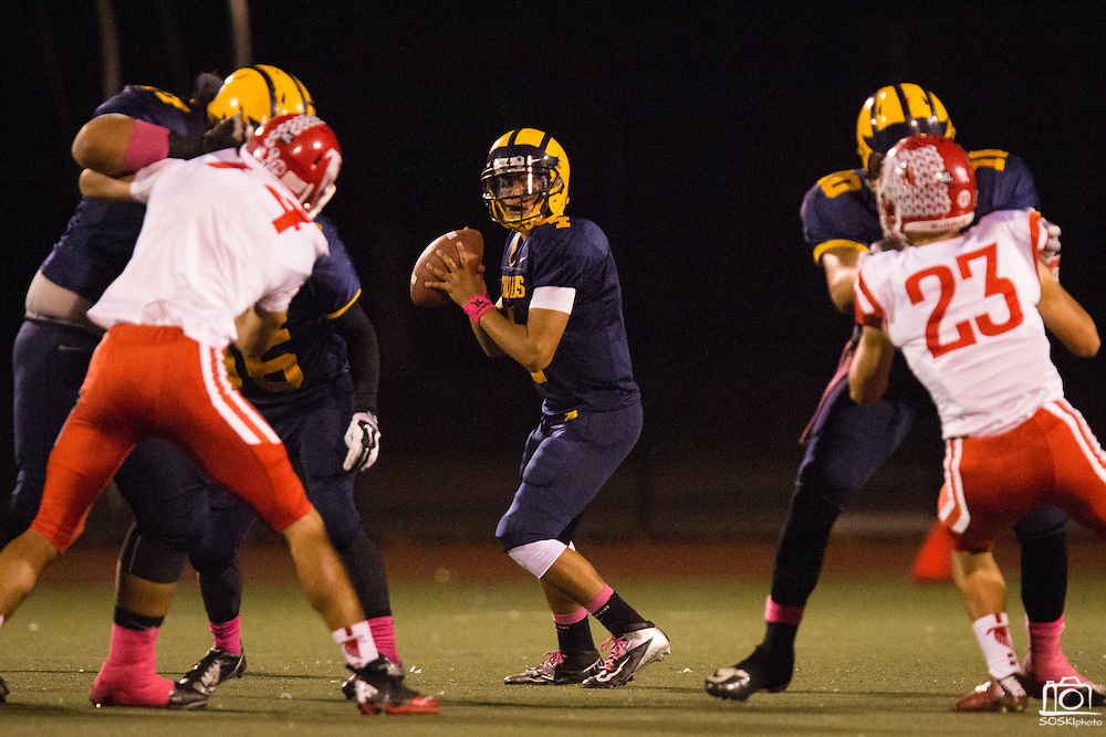 Milpitas quarterback John Keller (4) looks for an open receiver during the Homecoming game against Saratoga at Milpitas High School in Milpitas, California, on October 10, 2014. Milpitas beat Saratoga 49-0. (Stan Olszewski/SOSKIphoto)