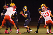 Milpitas quarterback John Keller (4) looks for an open receiver during the Homecoming game against Saratoga at Milpitas High School in Milpitas, California, on October 10, 2014. Milpitas beat Saratoga 49-0. (Stan Olszewski/SOSKIphoto)