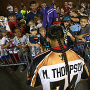 Miles Thompson #74 of the Rochester Rattlers signs autographs following the game at Harvard Stadium on August 9, 2014 in Boston, Massachusetts. (Photo by Elan Kawesch)