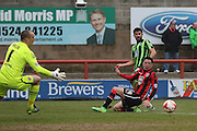 George Francomb of AFC Wimbledon sends the ball across the box during the Sky Bet League 2 match between Morecambe and AFC Wimbledon at the Globe Arena, Morecambe, England on 12 March 2016. Photo by Stuart Butcher.