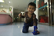 WUHAN, CHINA - MAY 28: (CHINA OUT) <br /> <br /> Fingerless Boy Wears 3D Printed Artificial Limb<br /> <br /> Six-year-old boy who lost the five fingers of his left hand tries out an artificial limb with 3D printing on May 28, 2015 in Wuhan, Hubei province of China. Handicapped Chinese boy received an artificial limb for free from Wuhan Union Hospital as a gift of the upcoming Children\'s Day which falls on June 1. The boy had to cut all his five fingers due to an accident when he was four years old. Both of his parents are working as migrants in another city and the poor family could not afford the use of an ordinary artificial limb which cost about 100,000 yuan (US$16,000) in China. 3D printed skills have been famous in recent years and Chen Zhnengbing, directo of  surgical department in Wuhan Union Hospital found the skill and promoted it freely to the boy. It took seven hours to print out a hand which enables the boy to hold, carry light things and do some simple jobs.<br /> ©Exclusivepix Media