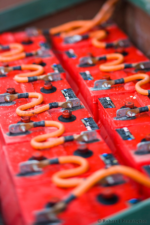 Bank of deep cycle red batteries that store power from photovoltaic panels.