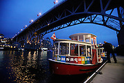 The Aquabus Ferry prepares to take off from Granville Island in Vancouver, B.C. The ferries constantly carry pedestrians and cyclists across Vancouver's False Creek inlet.  The Granville Street Bridge is in the background. (Erika Schultz / The Seattle Times)