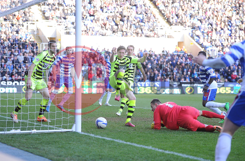 Yeovil Town's Jamie McAllister tries to stop the ball going over the line but fails. - Photo mandatory by-line: Alex James/JMP - Tel: Mobile: 07966 386802 01/03/2014 - SPORT - FOOTBALL - Reading - Madejski Stadium - Reading v Yeovil Town - Sky Bet Championshipe