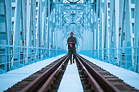 Nature manager and controler Bojan T. on the border between Croatia and Serbia, a new rail way bridge which was bombed during the war, Gornje Podunavlje Special Nature Reserve, Serbia