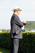 Trainer JOHN GOSDEN looks out on to the track as LOGICIAN wins The Group 1 William Hill St Leger Stakes over 1m 6f (£700,000)  during the fourth and final day of the St Leger Festival at Doncaster Racecourse, Doncaster, United Kingdom on 14 September 2019.