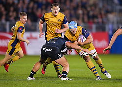 Jordan Crane (capt) of Bristol Rugby is tackled by Michael van Vuuren of Bath Rugby - Rogan Thomson/JMP - 20/10/2016 - RUGBY UNION - The Recreation Ground - Bath, England - Bath Rugby v Bristol Rugby - EPCR Challenge Cup.