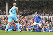 midfielder Ross Barkley sets up a shooting opportunity during the Barclays Premier League match between Everton and Manchester City at Goodison Park, Liverpool, England on 23 August 2015. Photo by Simon Davies.