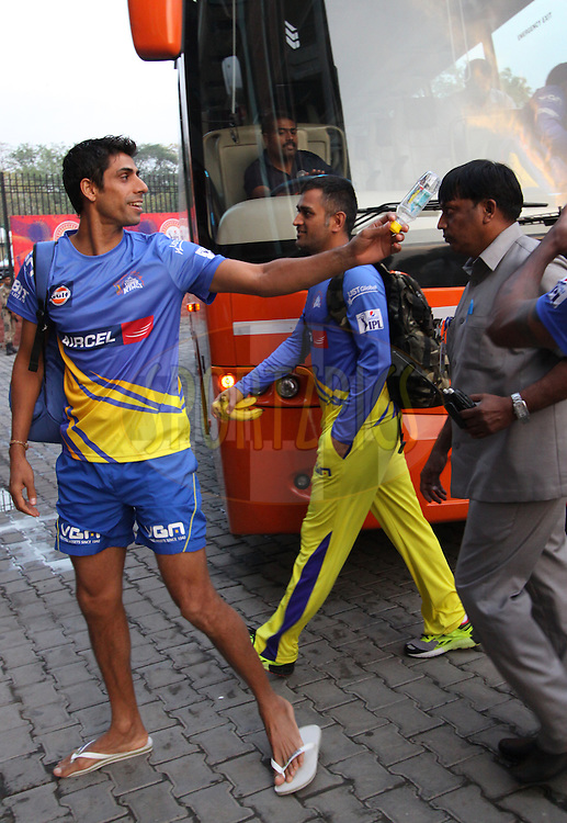 MS Dhoni captain of The Chennai Superkings and Ashish Nehra arrive before  match 26 of the Pepsi Indian Premier League Season 2014 between the Delhi Daredevils and the Chennai Superkings held at the Ferozeshah Kotla cricket stadium, Delhi, India on the 5th May  2014<br /> <br /> Photo by Arjun Panwar / IPL / SPORTZPICS<br /> <br /> <br /> <br /> Image use subject to terms and conditions which can be found here:  http://sportzpics.photoshelter.com/gallery/Pepsi-IPL-Image-terms-and-conditions/G00004VW1IVJ.gB0/C0000TScjhBM6ikg