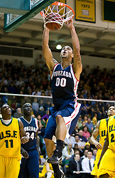 January 30, 2010; San Francisco, CA, USA;  Gonzaga Bulldogs center Robert Sacre (00) dunks against the San Francisco Dons during the first half at the War Memorial Gym.   San Francisco defeated Gonzaga 81-77 in overtime.