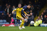 Gavin Whyte of Oxford United holds Ben Coker of Southend United off the ball during the EFL Sky Bet League 1 match between Southend United and Oxford United at Roots Hall, Southend, England on 6 October 2018.
