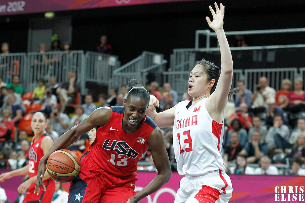 05 August 2012: USA Sylvia Fowles drives past China Xiaoli Chen during 114-66 Team USA victory over Team China, during the women's basketball preliminary, at the Basketball Arena, in London, Great Britain.