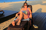 Woman relaxing in sun lounger Nilavelli beach, near Trincomalee, Eastern province, Sri Lanka, Asia