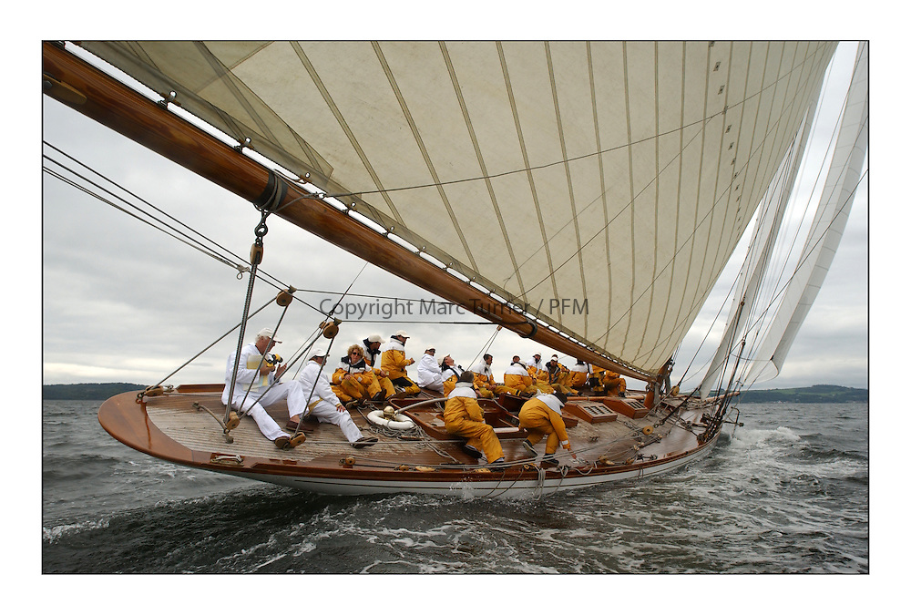 The stern of The Lady Anne, a 15 metre (95') Gaff Cutter built in 1912 originally for George Coats of Glasgow. Powered up heading for Rothesay...This the largest gathering of classic yachts designed by William Fife returned to their birth place on the Clyde to participate in the 2nd Fife Regatta. 22 Yachts from around the world participated in the event which honoured the skills of Yacht Designer Wm Fife, and his yard in Fairlie, Scotland...Marc Turner / PFM Pictures