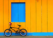 Bicycle leans against a colorfully painted building in the port town of Moyogalpa on Ometepe Island in Lake Nicaragua.