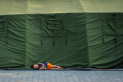 October 4, 2018 - Palu, Indonesia - A boy falls asleep beside the tent at the Korem Refugee settlement in Palu. A deadly earthquake measuring 7.7 magnitude and the tsunami wave caused by it has destroyed the city of Palu and much of the area in Central Sulawesi. According to the officials, death toll from devastating quake and tsunami rises to 1,347, around 800 people in hospitals are seriously injured and some 62,000 people have been displaced in 24 camps around the region. (Credit Image: © Hariandi Hafid/SOPA Images via ZUMA Wire)