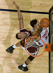 Virginia Cavaliers forward/center Ryan Pettinella (34) shoots against VT.  The Virginia Cavaliers Men's Basketball Team defeated the Virginia Tech Hokies 69-56 at the John Paul Jones Arena in Charlottesville, VA on March 1, 2007.