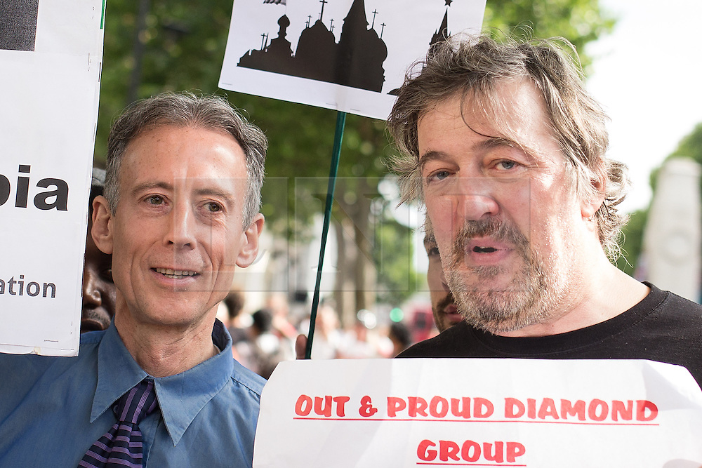 "© Licensed to London News Pictures . 10/08/2013 . London , UK . PETER TATCHELL and STEPHEN FRY at the demonstration . Protesters with placards . Demonstration against homophobic laws being enacted in Russia on Whitehall this afternoon (10th August 2013) . Legislation includes banning gay pride events for100 years , banning the distribution of "" propaganda of non-traditional sexual relations "" to minors , making it illegal for the adoption of Russian children by gay couples or any single person who comes from a country that recognises marriage equality and giving authorities the rights to arrest foreign nationals whom they suspect are LGBT or pro gay with the right to detain them for up to 14 days. Photo credit : Joel Goodman/LNP"