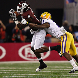 Jan 7, 2011; Arlington, TX, USA; Texas A&M Aggies wide receiver Jeff Fuller (8) catches a pass in front of LSU Tigers cornerback Patrick Peterson (7) during the second quarter of the 2011 Cotton Bowl at Cowboys Stadium.  Mandatory Credit: Derick E. Hingle