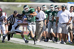 08 September 2012:  Alex Garvey avoids the tackle and the out of bounds during an NCAA division 3 football game between the Alma Scots and the Illinois Wesleyan Titans which the Titans won 53 - 7 in Tucci Stadium on Wilder Field, Bloomington IL