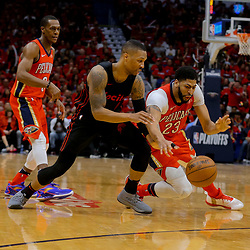 Apr 19, 2018; New Orleans, LA, USA; New Orleans Pelicans forward Anthony Davis (23) scrambles with Portland Trail Blazers guard Damian Lillard (0) for a loose ball during the second half in game three of the first round of the 2018 NBA Playoffs at the Smoothie King Center. The Pelicans defeated the Trail Blazers 119-102.  Mandatory Credit: Derick E. Hingle-USA TODAY Sports